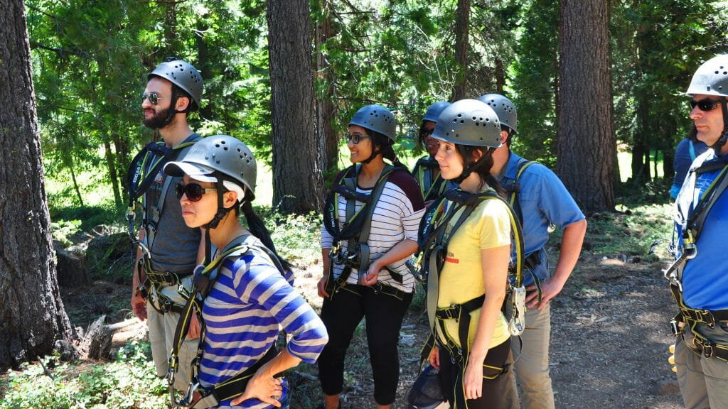 Sarah Carvill (center) and other 2016 CCST Science & Technology Policy Fellows look ahead to their professional development retreat in Lake Tahoe in July. But first, the ropes course.