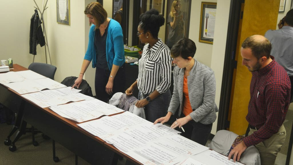 """Photo of Jen Chase and her 2017 CCST Science Fellows cohort do their best to assemble the California legislative calendar in its correct sequence, during their """"policy boot camp"""" training month at CCST."""