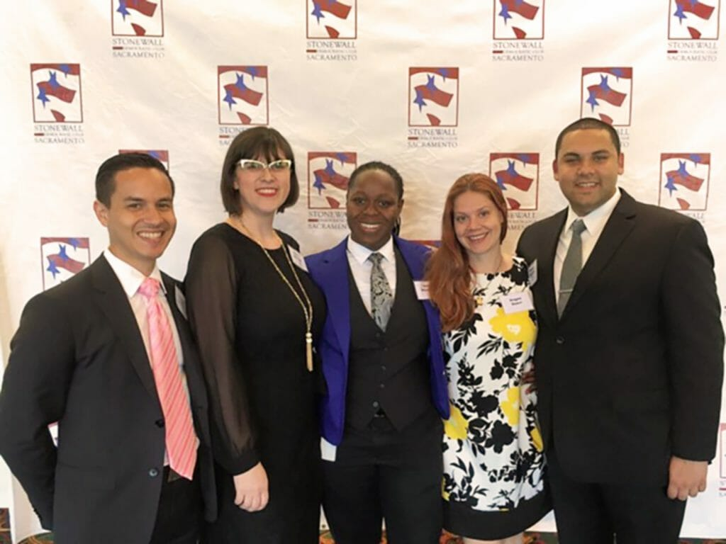 Standing left to right are David Ernest Garcia '14, Dharia McGrew '12, Jane Mantey '15, Angee Doerr '15, and Estevan Santana '15 gather for Sacramento Stonewall Democrats social.