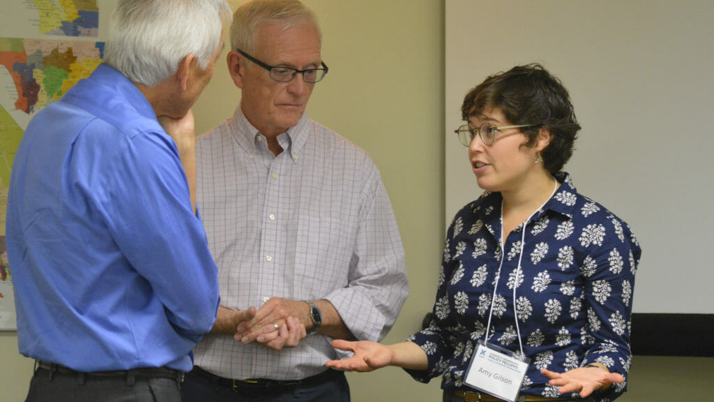 2018 CCST Science Fellow Amy Gilson puts on her acting hat during a mock networking session with CCST advisors Randy Chinn (left) and Doug Brown.