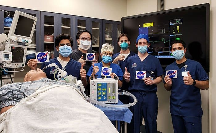 NASA JPL scientists giving a thumbs up after testing a prototype ventilator