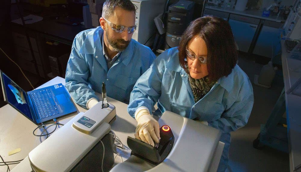 LLNL researchers working on the development of a tularemia vaccine. (Credit: Julie Russell/LLNL)