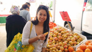 Bao-Ngoc Nguyen, PhD, is a 2017 CCST Science & Technology Policy Fellow, seen here exploring the Sacramento Central Farmers Market on a spring Sunday.
