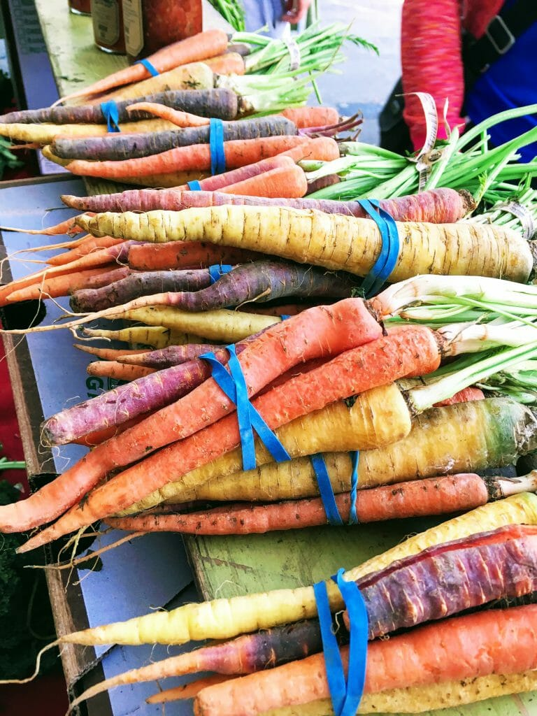 Photo of multicolored carrots at a vegetable stand. Sacramento's central city area has several farmers markets, including a Wednesday market within walking distance from the State Capitol during the summer season. (Photo courtesy of Bao-Ngoc Nguyen)