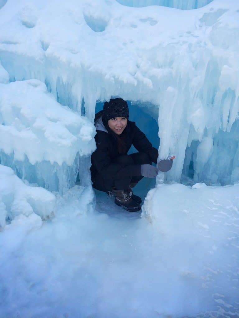 Pajau exploring ice castles during graduate school at the University of Minnesota.