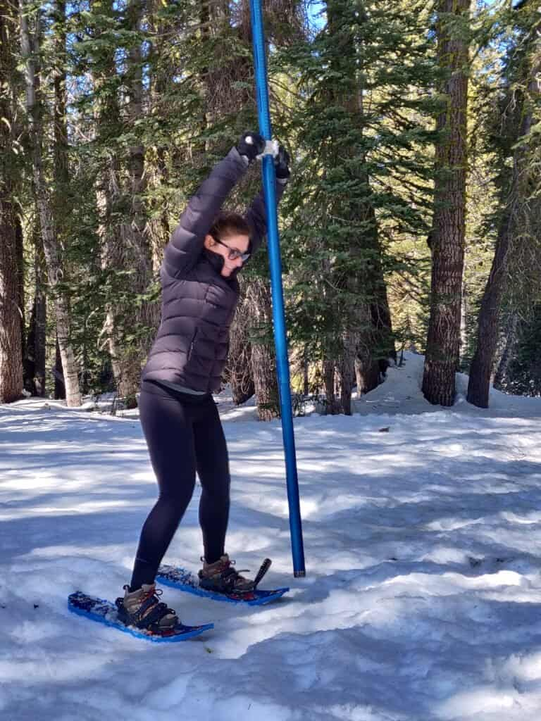 2020 CCST Science Fellow Rachel Silvern prepares to drive a tube into the snowpack.