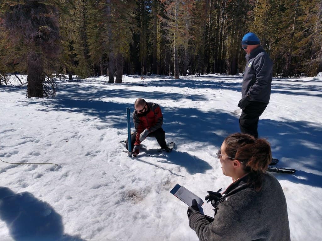 2020 CCST Science Fellow Grayson Doucette prepares to read the depth of the snowpack