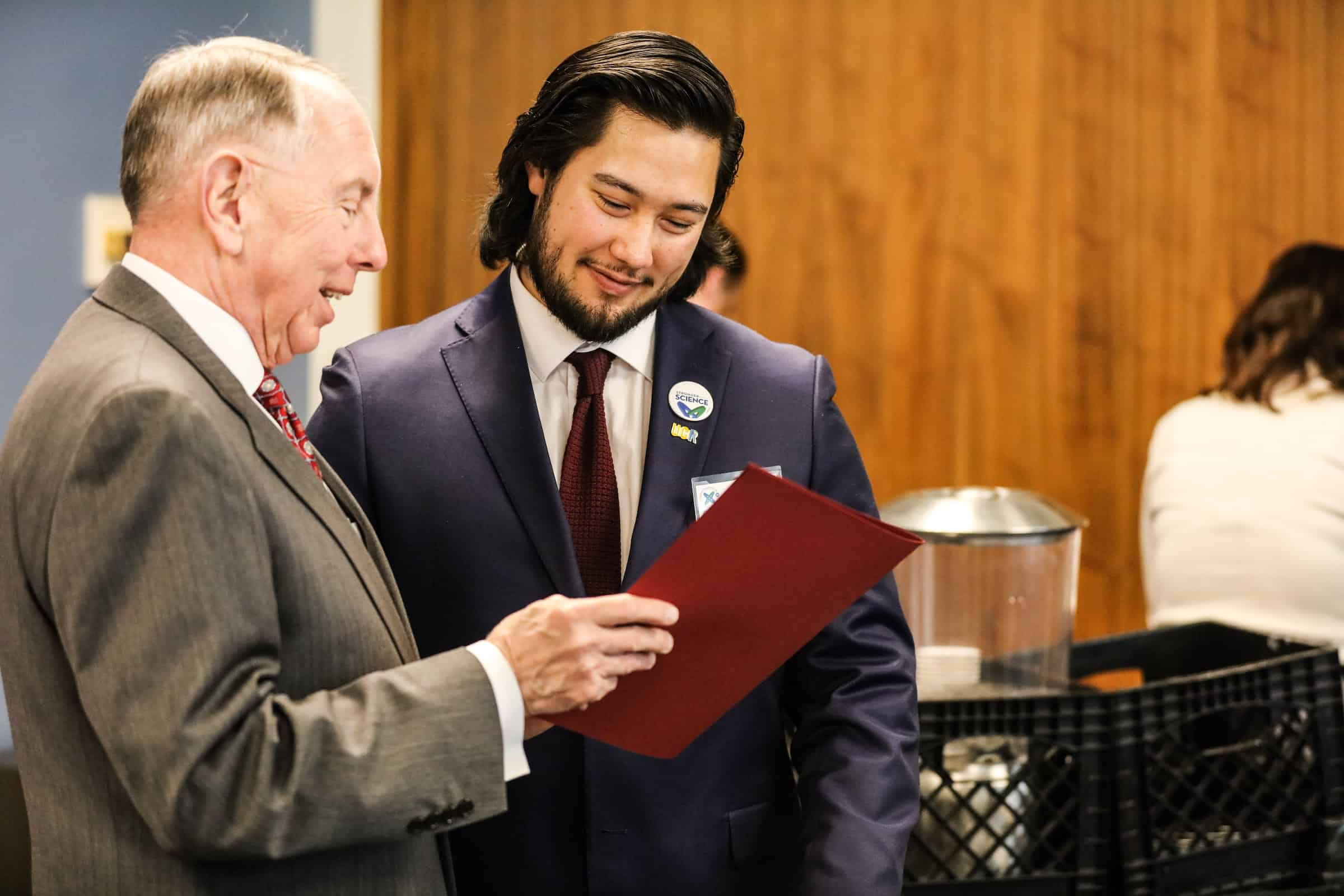 Senator Richard Roth presents William with a Senate Certificate of Recognition.
