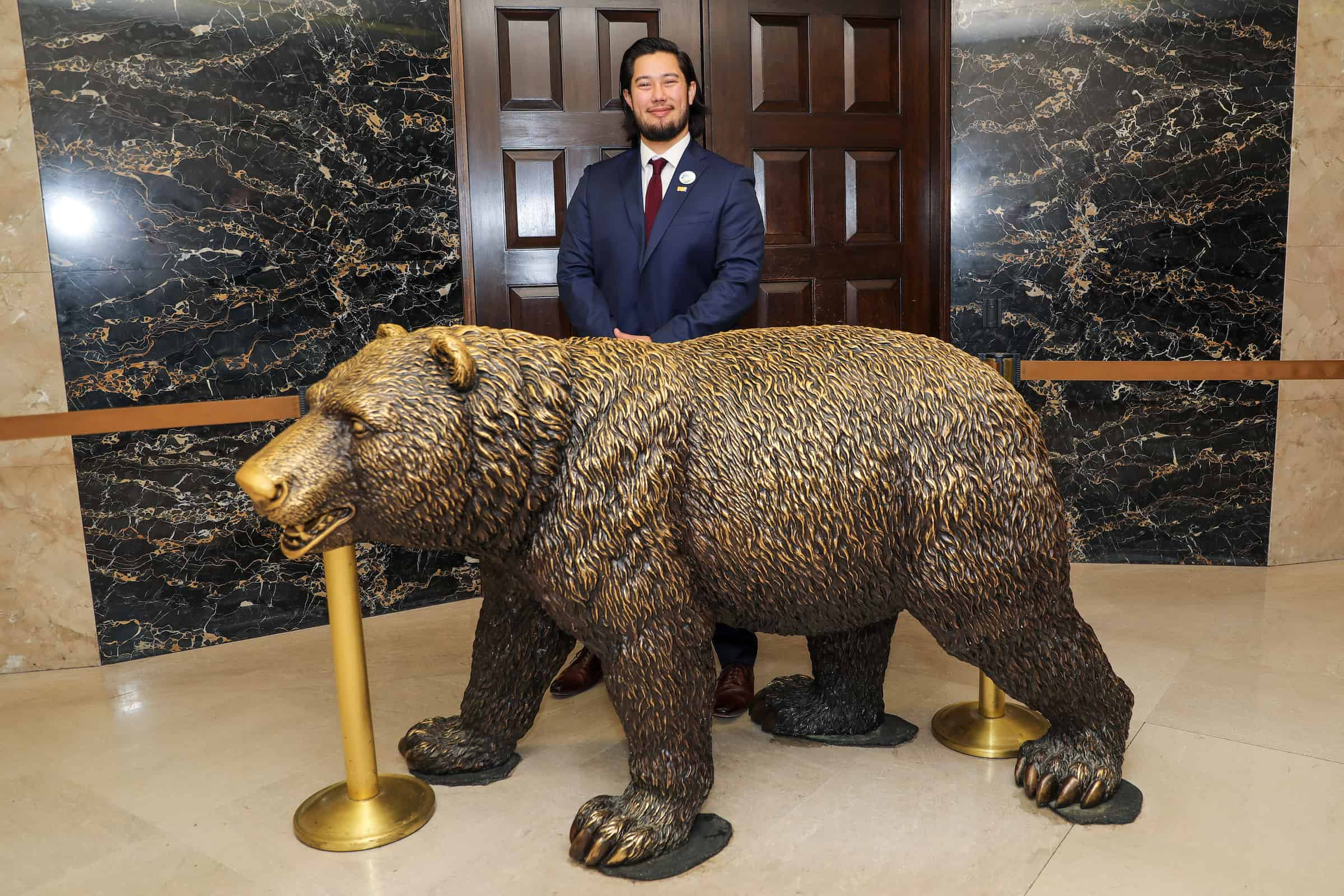 """William in front of the Governor's Office with """"bacteria bear."""""""